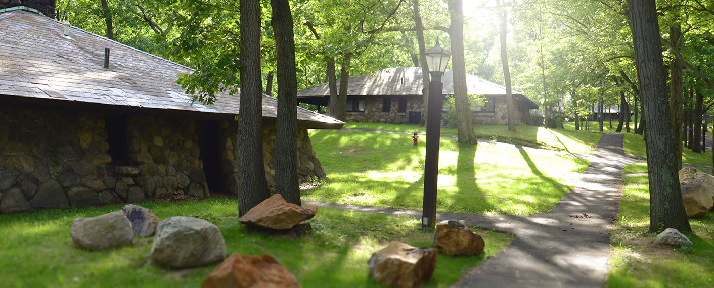 Stone Cottages along a path through the woods