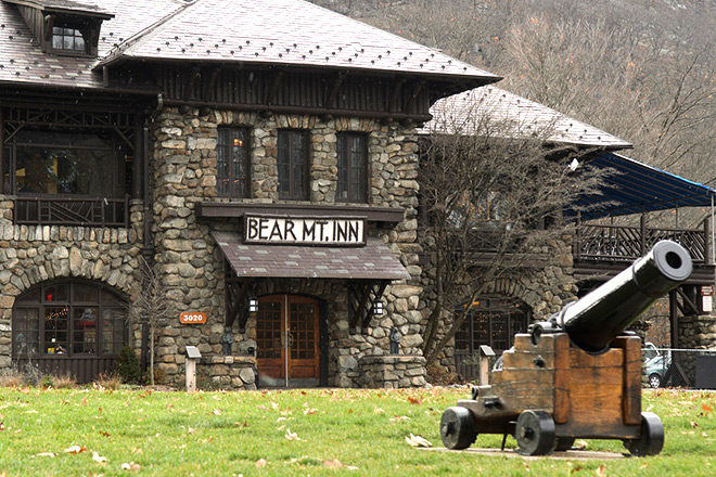 Exterior of Bear Mountain Inn with a cannon in the foreground